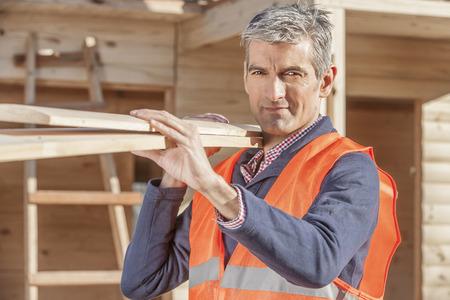 Older serious looking man at construction site Banco de Imagens