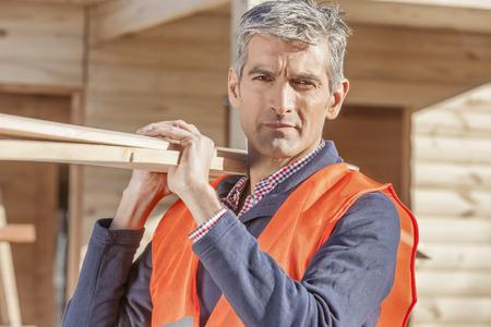 Older serious looking man at construction site Foto de archivo