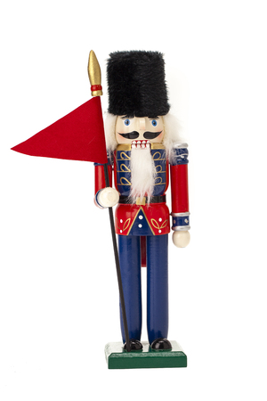 Traditional Figurine Christmas Nutcracker isolated on white Stock Photo