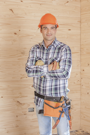 A layman in hard hat on construction site