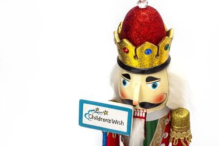 nut cracker: Traditional Figurine Christmas Nutcracker isolated on white Stock Photo