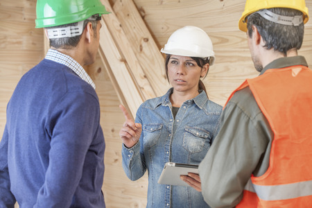 Construction crew listening to female supervisor