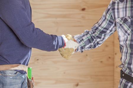 Construction men shaking hands