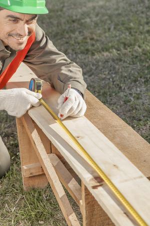 close-up of construction worker hands measuring Foto de archivo