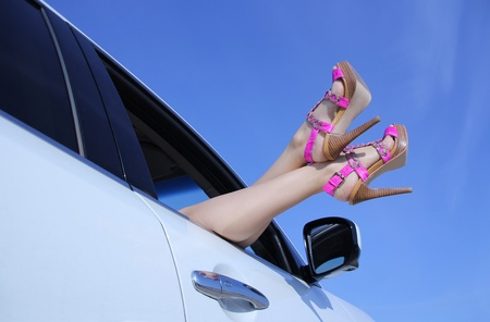 Women s legs sticking out of the car photo