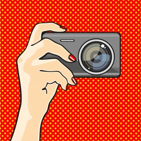 arte optico: Ilustraci�n de una mano que sostiene una c�mara de fotos