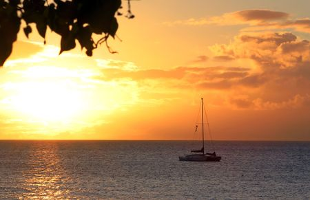 serine: Hawaiian sunset boat looking out from Lahaina Mau Stock Photo