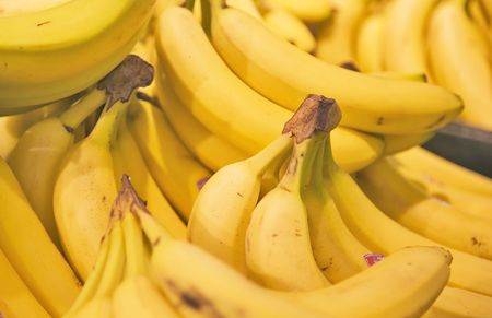 pappy: A display of yellow bunches of Bananas in a Grocery Store. Stock Photo
