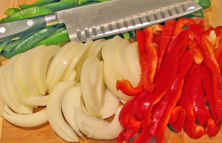 greem: Sliced Vegetables with a Knife on a Cutting Board