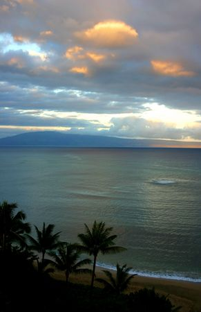 serine: Maui Sunset with palm trees and Molokai in the background Stock Photo
