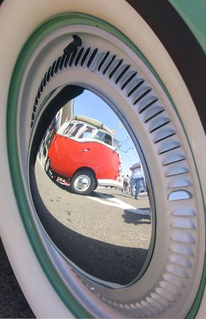 hub: Reflection of a Surf Bus in a Hub Cap