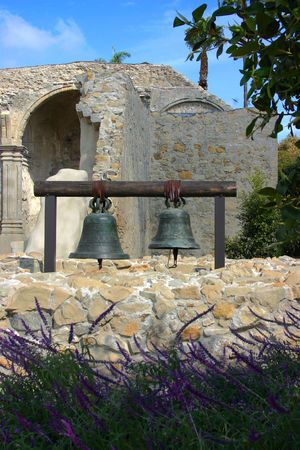 Two Bells hanging at Mission San Juan Capistrano with the ruins in the background. photo