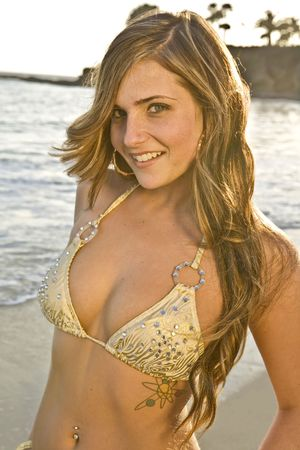 Young Brunette Woman on the Beach in a Bikini Close up photo