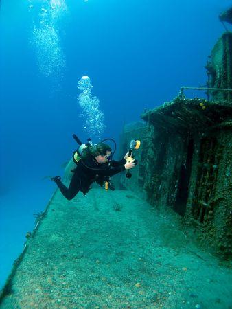 brac: Underwater Photographer shooting a Sunken Ship in Cayman  Brac