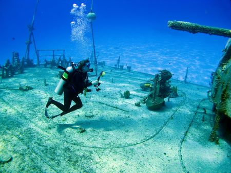 cayman: Underwater Photographer shooting the shipwreck Tibbits in Cayman Brac