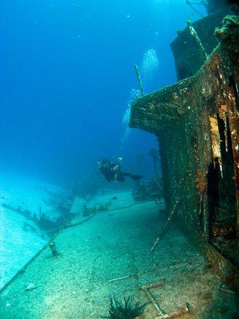 cayman: Underwater Photographer Shooting a Sunken Ship in Cayman Brac