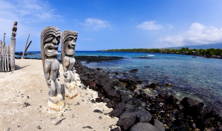 hawaiian tiki: Wide Angle Tkis at Place of Refuge in Kona Hawaii Stock Photo