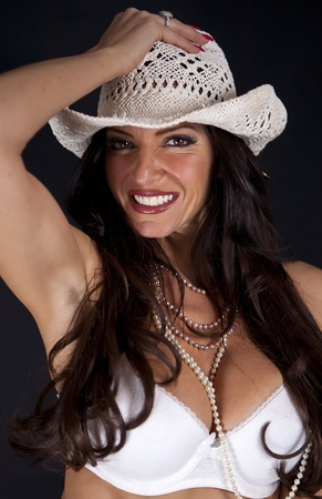 Smiling woman wearing a White Hat
