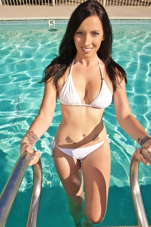 Beautiful Brunette with a tattoo exiting a Pool photo