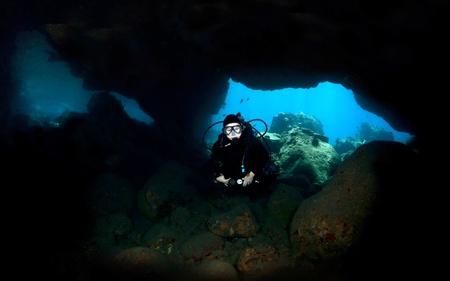 kona: Diver in Lava Tube in Kona Hawaii close up