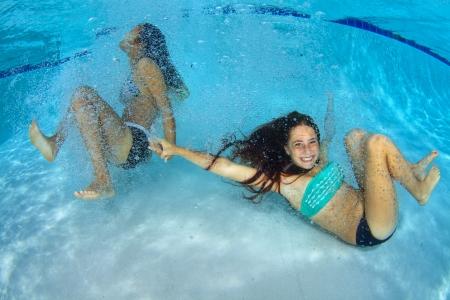 Girls having fun underwater