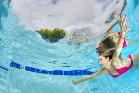 swimming underwater: Young sexy woman swimming underwater