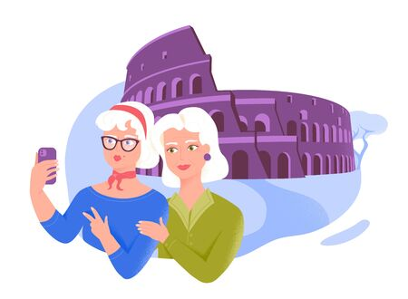 Two senior female friends taking selfie near the Coliseum. Active leisure and special offers for older people.