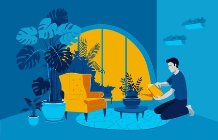 Young man taking care and watering ZZ plant with funnel at home garden. Indoor gardening hobby. Jungles inspired interior in modern city apartment. Cozy and calming room decorated with many plants.