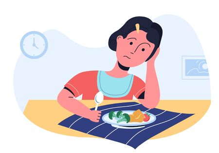 Sad girl looking on her plate with vegetables and refusing to try. Picky eater and bad appetite. Parenting challenges.