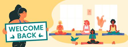 Yoga instructor holds welcome back banner, informing her clients about the resumption of yoga classes after covid-19 lockdown. Women doing padmasana or lotus pose. Physical and mental health.