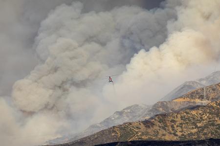 Helicopter flying through dense smoke