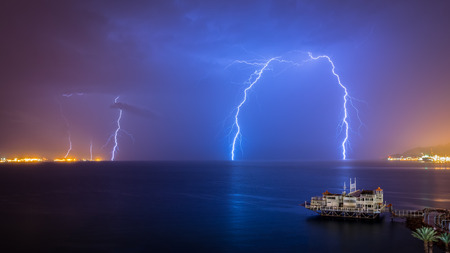Dramatic Lighting Storm Over The Red Sea Eilat Israel Stock Photo