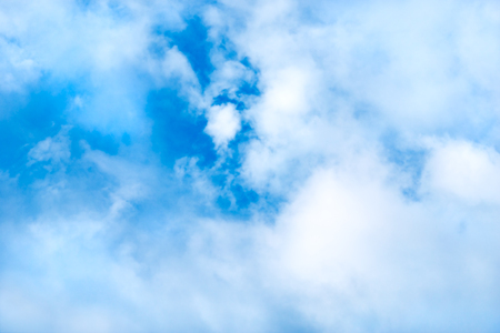 Dreamy Cloud Background  -Blue sky filled with white puffy clouds