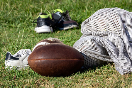 American Football gear laying on practice field