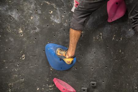 Rock Climber climbing on the wall - Indoor climbing gym