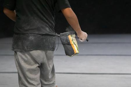 Rock Climber applying chalk powder for Boulder or Rock Climbing - Indoor Climbing gym