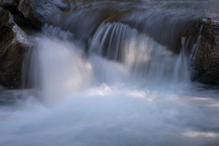 Flowing water of the rocks in mountain river  stream in Bishop, California Imagens