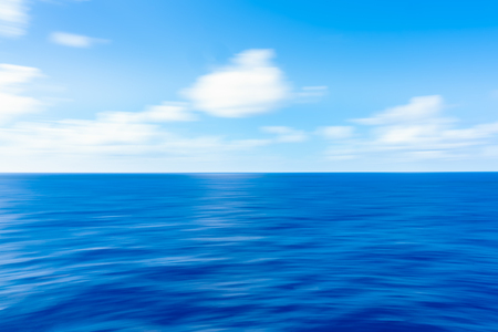 Soft Ocean Waves with White Clouds against a blue sky