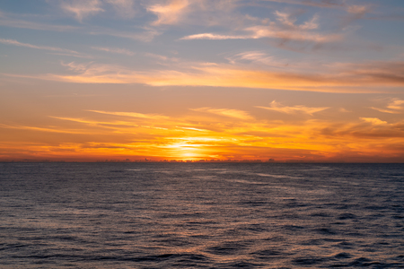 Sunset on the Caribbean Sea. Beautiful yellow and orange sky with clouds Imagens
