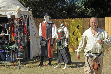 November 12, 2011, Sarasota, Florida, USA - Sarasota, Florida - Man in costume walks away from booth where 13th century style clothing is sold to people attending the Sarasota Medieval Fair, November 12-13 and 19 - 20..