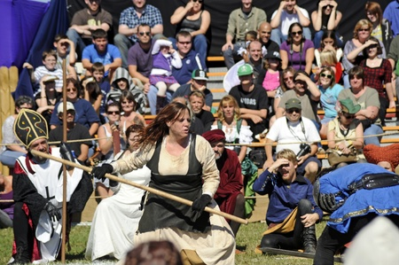 November 12,2011 - Sarasota, Florida - A peasant woman in 11th century Britian fights off a tax collector as the Bishop, Queen, King Richard II, and modern day crowd watch during 2011 Sarasota Medieval Fair, November 12-13 and 19 - 20. . Editorial