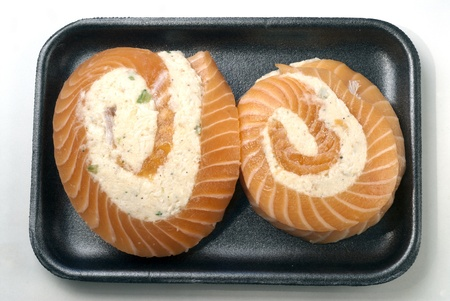 Salmon pinwheels with crabmeat on styrofoam tray
