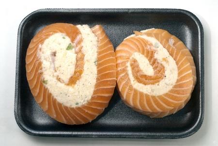 pinwheels: Salmon pinwheels with crabmeat on styrofoam tray