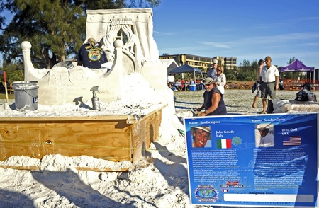 Master Sandsculptors John Gowdy and Brad Goll work on their entry in Sarasota Crystal Classic 2011.  The men Stock Photo - 11241047