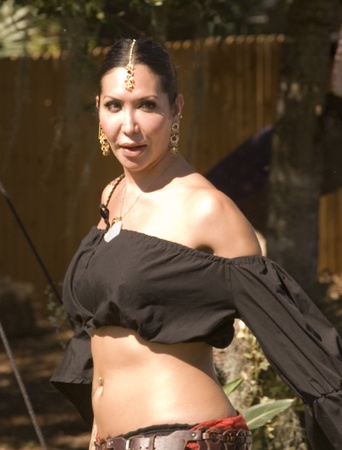 November 12-13 and 19-20, 2011.- Sarasota, Florida, USA -  Beautiful dark haired gypsy dancer at the Sarasota Medieval Fair.