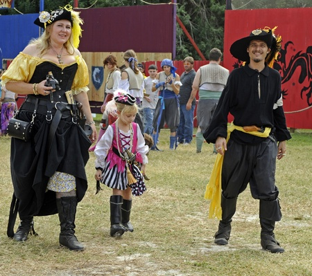 November 12-13 and 19-20, 2011.- Sarasota, Florida, USA -  Many people who attend the Sarasota Medieval Fair dress in costume like this family dressed as pirates. Editorial