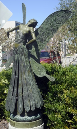 Butterfly Lady, bronze sculpture by August Moreau, stands on a street corner in downtown Sarasota, Florida.