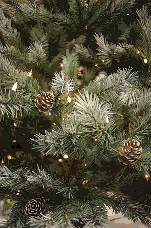 close up of artificial pine tree with pine cones and string of white christmas tree