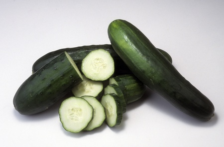 Cucumbers whole and sliced showing crossections.