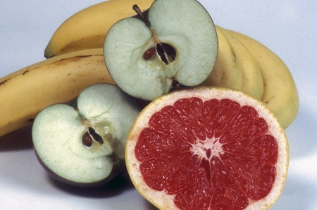 Fresh fruit group with grapefruit, apples and bananas.